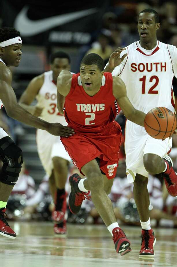Travis' Aaron Harrison ended up with 13 points and 10 rebounds in the UIL Class 5A championship game last weekend. Photo: Karen Warren, Staff / © 2013 Houston Chronicle