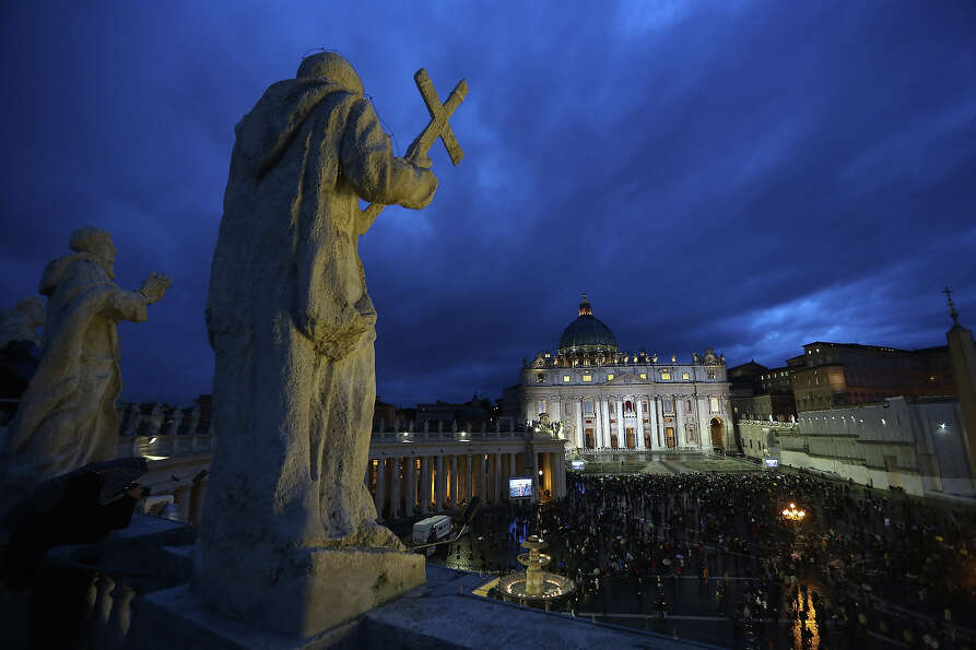 People gather in St Peter's Square as Cardinals meet in the Sistine Chapel for the 1st day of the co