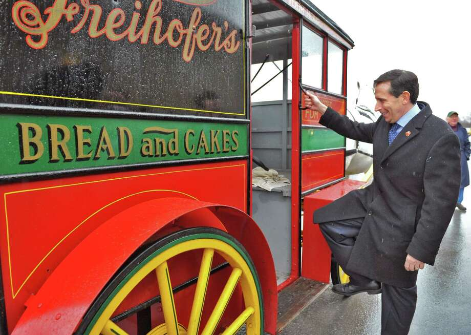"Freihofer's vice president of sales Mike Loscalzo boards a horse-drawn wagon as the Charles Freihofer Baking Company kicks off its 100th anniversary with a year-long celebration, beginning with the unveiling of the honorary ""Freihofer?s Way"" street sign located on Prospect Avenue, the home of Freihofer?s bread bakery Tuesday March 12, 2013.  (John Carl D'Annibale / Times Union) Photo: John Carl D'Annibale / 10021493A"