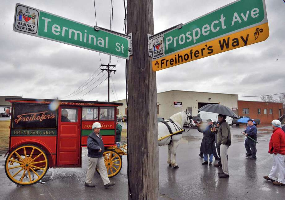 "An old Freihofer horse-drawn wagon at the new ""Freihofer?s Way"" street sign located on Prospect Avenue, the home of Freihofer?s bread bakery Tuesday March 12, 2013.  (John Carl D'Annibale / Times Union) Photo: John Carl D'Annibale / 10021493A"