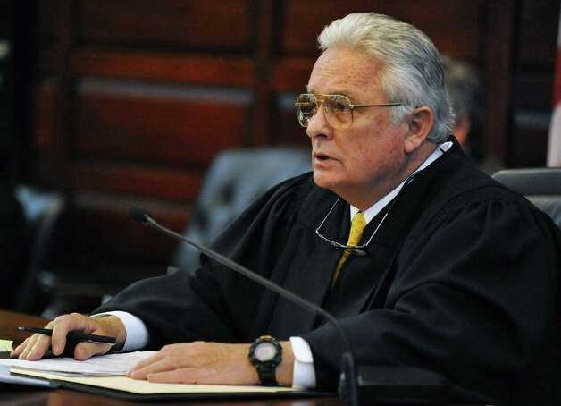 Acting state Supreme Court Justice George J. Pulver during sentencing for four city Democrats sentenced in ballot fraud cases at Rensselaer County Courthouse in Troy Tuesday March 12, 2013.  (John Carl D'Annibale / Times Union) Photo: John Carl D'Annibale / 10021501A