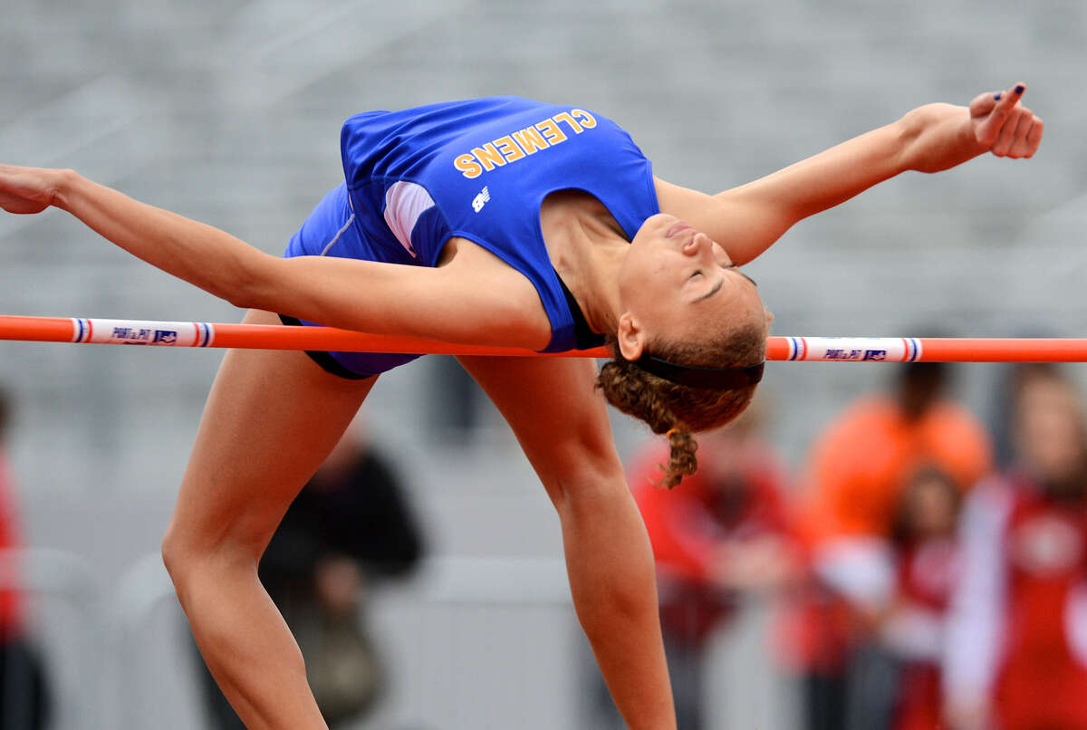 Clemens's Courtney Johnson clears 5-4 to win the girls high jump at the Judson Invitational Track Meet last Saturday at Rutledge Stadium. Judson's boys and girls teams defended their home turf in taking their respective titles.