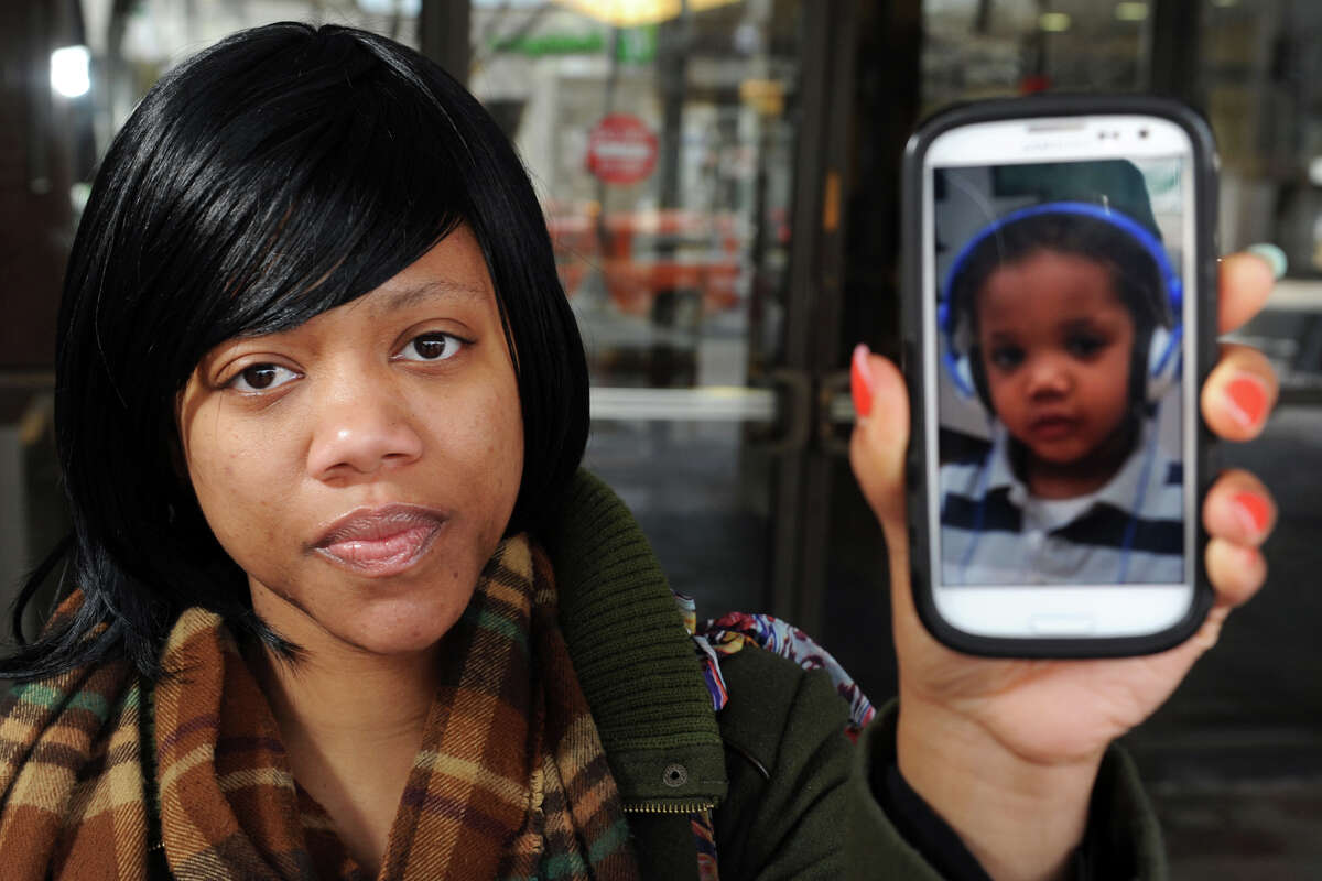 Brittany Finley displays a photo of her 2-year old son, John-Michael DeVone Jr., in Bridgeport, Conn. March 11th, 2013.