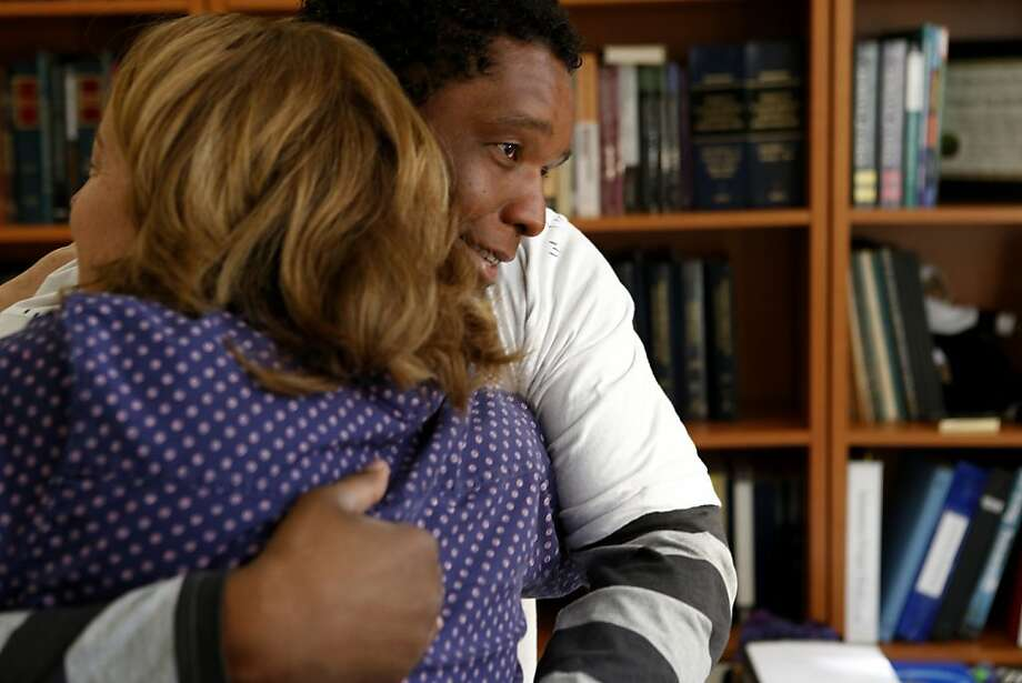 Johnny Williams of East Oakland hugs a member of the media after an interview at the Northern California Innocence Project offices in Santa Clara. Photo: Beck Diefenbach, Special To The Chronicle