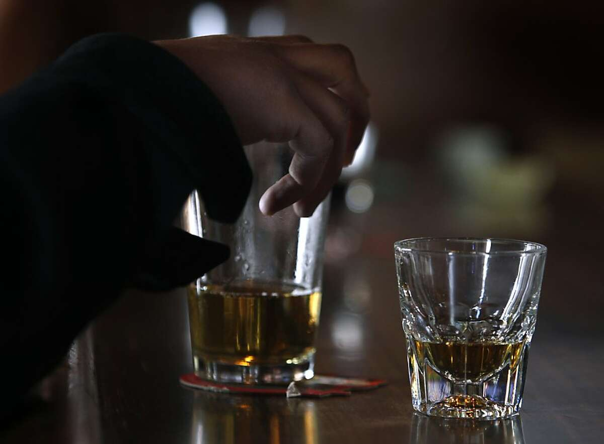 A customer orders a beer and bourbon at the Tempest bar and restaurant in San Francisco, Calif. on Tuesday, March 12, 2013. Sen. Mark Leno is introducing a bill in Sacramento that would allow bars to serve alcohol until 4 a.m.