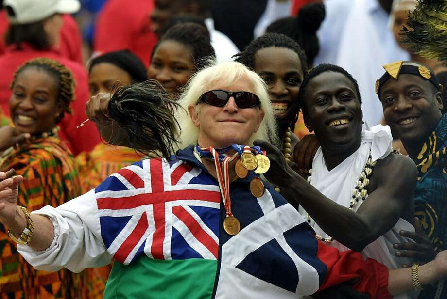 Revelations that longtime television personality Jimmy Savile (center) was one of the country's most prolific sex offenders have shocked Britons. Photo: Adrian Dennis, AFP/Getty Images