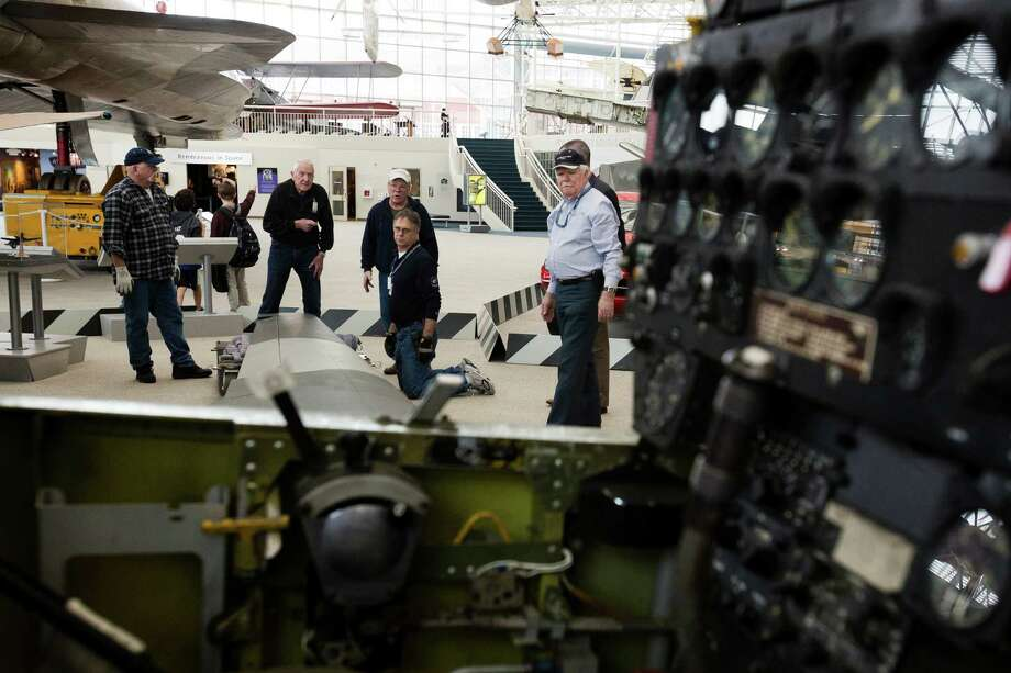 Museum of Flight volunteers and staffers help to lift the wings of a Vietnam War-era YO-3A spy plane into position for a new permanent installation Tuesday, March 12, 2013, at the Museum of Flight in Seattle. The aircraft - only one of 11 ever made - was the first plane to utilize infrared technology to identify enemy targets silently from the air. Photo: JORDAN STEAD / SEATTLEPI.COM
