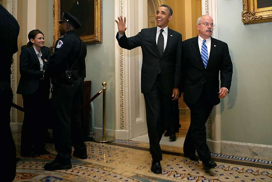 U.S. President Barack Obama is accompanied by Sergeant at Arms of the United States Senate Terrance