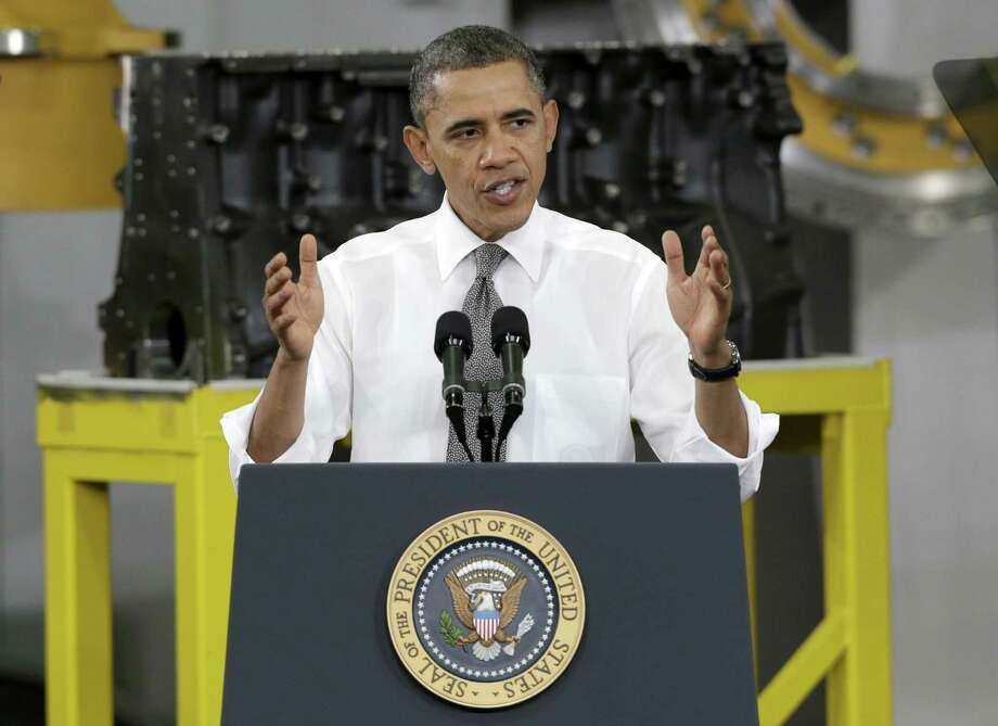 President Barack Obama speaks to workers and guests at the Linamar Corp. plant in Arden, N.C.  One letter writer says if minimum wage increases, labor union workers will get  large pay raises. Photo: Chuck Burton, Associated Press