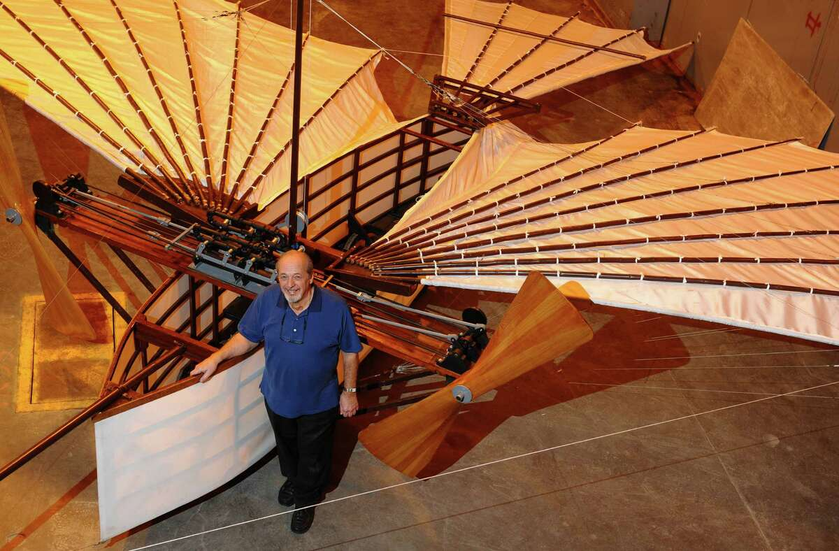 Andy Kosch stands with the replica of Gustave Whitehead's plane at the Connecticut Air and Space Center in Stratford, Conn. on Tuesday March 12, 2013. Kosch, president of the project and a member of the board of directors, helped build and fly the replica. For the 100th anniversary edition of Jane's All the World Aircraft, Whitehead's flyer will be given credit as the first operational heavier-than-air aircraft.