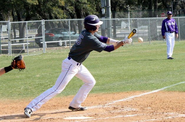Boerne High School outfielder Luke Baird lays down a perfect bunt during the Greyhounds' 6-2 win over West in the BISD Tournament. Photo: Mike Reeder / For The Northwest Weekly