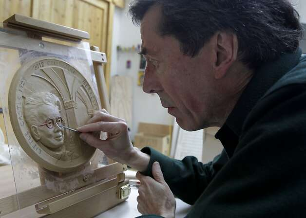 At his Kensington studio, Rob Firmin works on a likeness of architect Julia Morgan for a Berkeley City Club project. Photo: Paul Chinn, The Chronicle