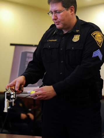 Bridgeport Police Sgt. Luigi Tucciarone demonstrates a gun lock during a press conference announcing Newtown-based National Shooting Sports Foundation's (NSSF) initiative to donate 2,500 gun safety locks to Bridgeport, Stratford, Fairfield and Waterbury to be distributed to residents free of charge Tuesday, Mar. 12, 2013 at the Margaret E. Morton Government Center in Bridgeport, Conn. Photo: Autumn Driscoll / Connecticut Post