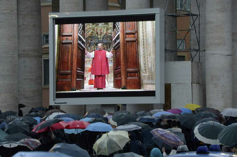 A giant video screen in St. Peter's Square was as close as the faithful could get to Tuesday's start of the papal conclave. Cardinals held their first deliberations to elect a new pope after Benedict XVI's shock resignation. Photo: ANDREAS SOLARO, Stringer / AFP