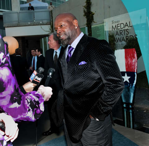Retired NFL runningback Emmitt Smith is interviewed on the red carpet of the 2013 Texas Medal of Arts gala on Tues., March 5, 2013 at the Long Center in Austin, TX.  Gene Jones and her daughter, Charlotte Jones Anderson, received the Indiviual Art Patron Award. Ashley Landis for the Houston Chronicle Photo: Ashley Landis, Contributor / copyright 2013 Ashley Landis