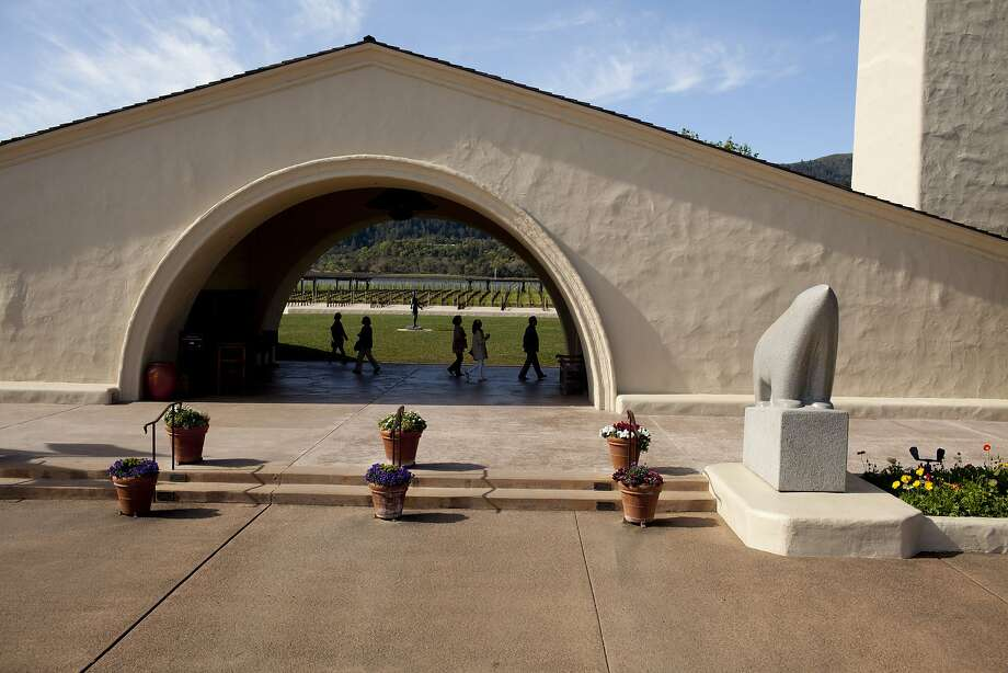 Guests arrive under the archway at the Robert Mondavi Winery in Napa, Calif., Friday, March 8, 2013. Photo: Jason Henry, Special To The Chronicle