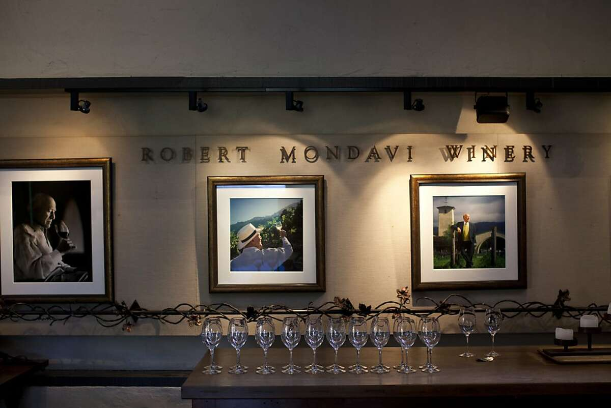 Photos of Robert Mondavi hang in a tasting room at the Robert Mondavi Winery in Napa, Calif., Friday, March 8, 2013.