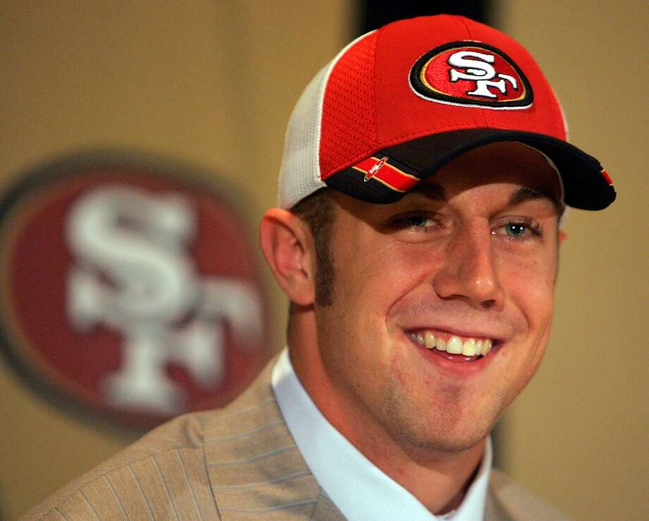 10. Alex Smith is taken No. 1 overall in the 2005 NFL Draft. Coming off the worst season in team history, the 49ers consider Michigan wide receiver Braylon Edwards, Cal quarterback Aaron Rodgers and Utah quarterback Alex Smith. After meeting with Smith repeatedly, they settle on him following one last test that involves an odd drill of throwing a ball from between his legs. Smith does the drill; Rodgers chooses not to. Head coach Mike Nolan goes with Smith, and Rodgers drops to the Packers with the 24th selection. We all know what has happened since. Photo: MARCIO JOSE SANCHEZ, AP / AP