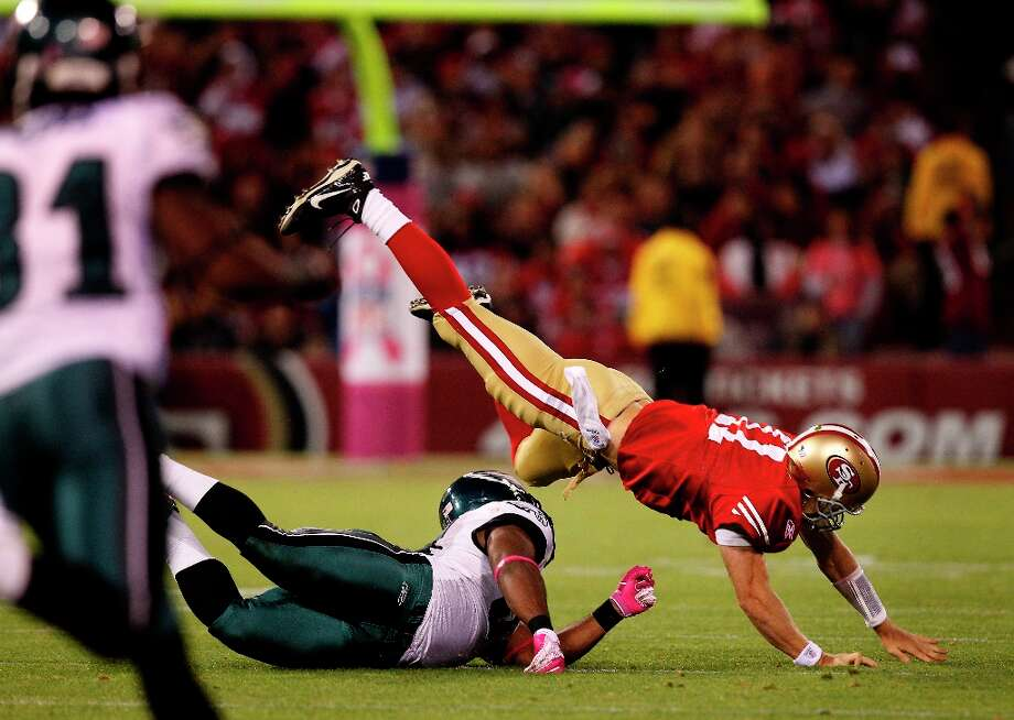 5. The 49ers are 0-4 in 2010 when they face the Eagles at home in a critical game. Smith fumbles in the first half, leading to a Philadelphia touchdown. Drama ensues on the sideline as Smith and Singletary have a confrontation that also involves tight end Vernon Davis. Smith goes on to throw three touchdown passes to nearly lead a stirring comeback. The 49ers lose 27-24 after Smith throws an interception when he is hit as he throws. Photo: Brant Ward, The Chronicle / SFC