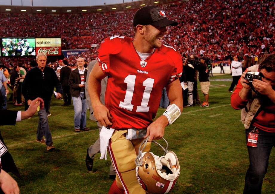 3. Jim Harbaugh is hired in 2011 and decides it would be too disruptive to switch quarterbacks in a strike-marred season. Smith has his golden year, capped by an unforgettable performance in a divisional playoff win against the Saints. He's widely recognized as an NFL rarity — a good quarterback. Photo: Brant Ward, The Chronicle / ONLINE_YES