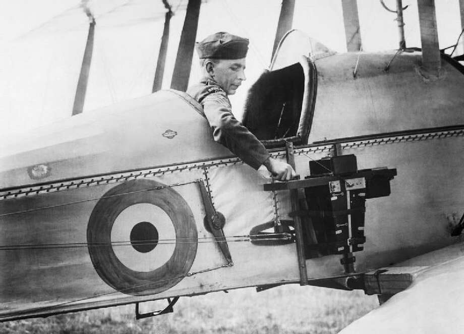It wasn't long after people started flying airplanes that someone thought to take a camera along. Development in aircraft and cameras through the subsequent decades brought huge advances to aerial surveillance. Here, an observer of the Royal Flying Corps in a Royal Aircraft Factory B.E.2c reconnaissance aircraft demonstrates an aerial reconnaissance camera fixed to the side of the fuselage in 1916. Photo: Royal Flying Corps.