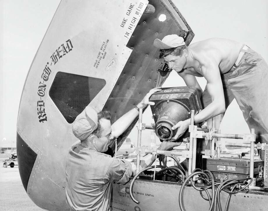 Air Force personnel install a camera in a Lockheed RF-80A during the Korean War. Photo: U.S. Air Force