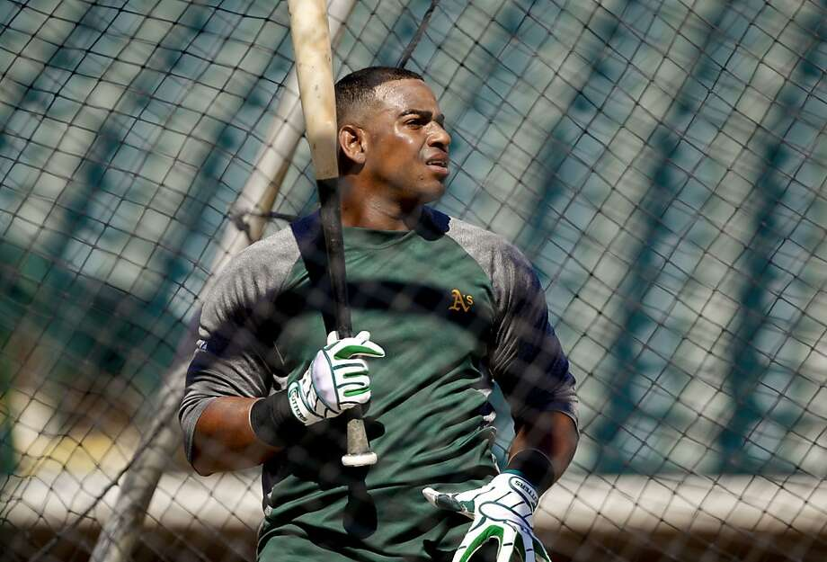 Yoenis Céspedes says he can relax and concentrate on baseball now that most of his family is in America. Photo: Michael Macor, The Chronicle
