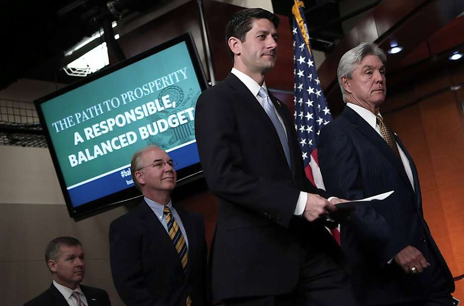 Rep. Paul Ryan (center) says the budget proposal follows what he and his supporters believe in. Photo: Win McNamee, Getty Images