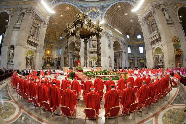 Cardinals attend a Mass for the election of a new pope celebrated by Cardinal Angelo Sodano inside St. Peter's Basilica, at the Vatican, Tuesday, March 12, 2013. Cardinals enter the Sistine Chapel on Tuesday to elect the next pope amid more upheaval and uncertainty than the Catholic Church has seen in decades: There's no front-runner, no indication how long voting will last and no sense that a single man has what it takes to fix the many problems. Photo: Andrew Medichini