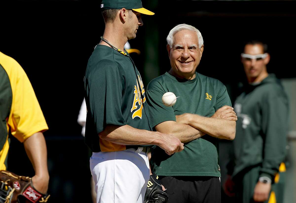 Oakland A's pitcher Grant Balfour, (50) talk with A's owner Lou Wolf, during morning workouts at Phoenix Municipal Stadium on Tuesday Mar. 12, 2013, in Phoenix, Az., as the Oakland Athletics prepare to take on the Kansas City Royals in Spring Training action.