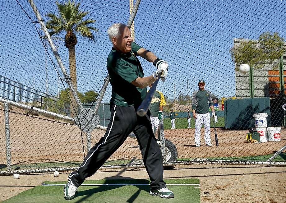 Owner Lew Wolff cuts a fine figure as he takes his swings in the batting cage at an auxiliary field during an A's workout. Photo: Michael Macor, The Chronicle