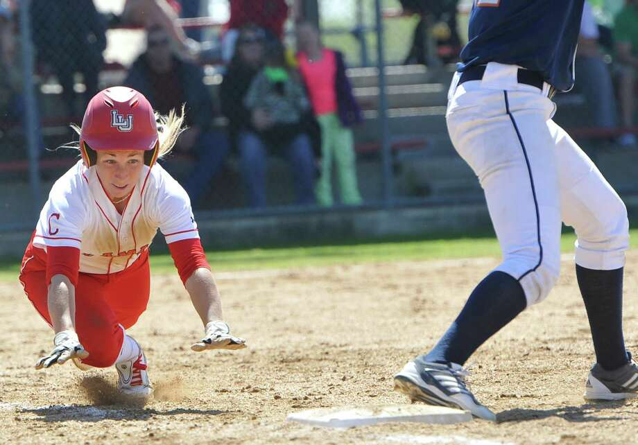 Lady Cardinal #11, Casey Cromwell dives for first base in the bottom of the forth inning. She was safe. The Lamar University Lady Cardinals softball team hosted a double header Tuesday afternoon at Ford Park with the Bucknell Bison.  The Lady Cards lost the first game 2-1.  Dave Ryan/The Enterprise
