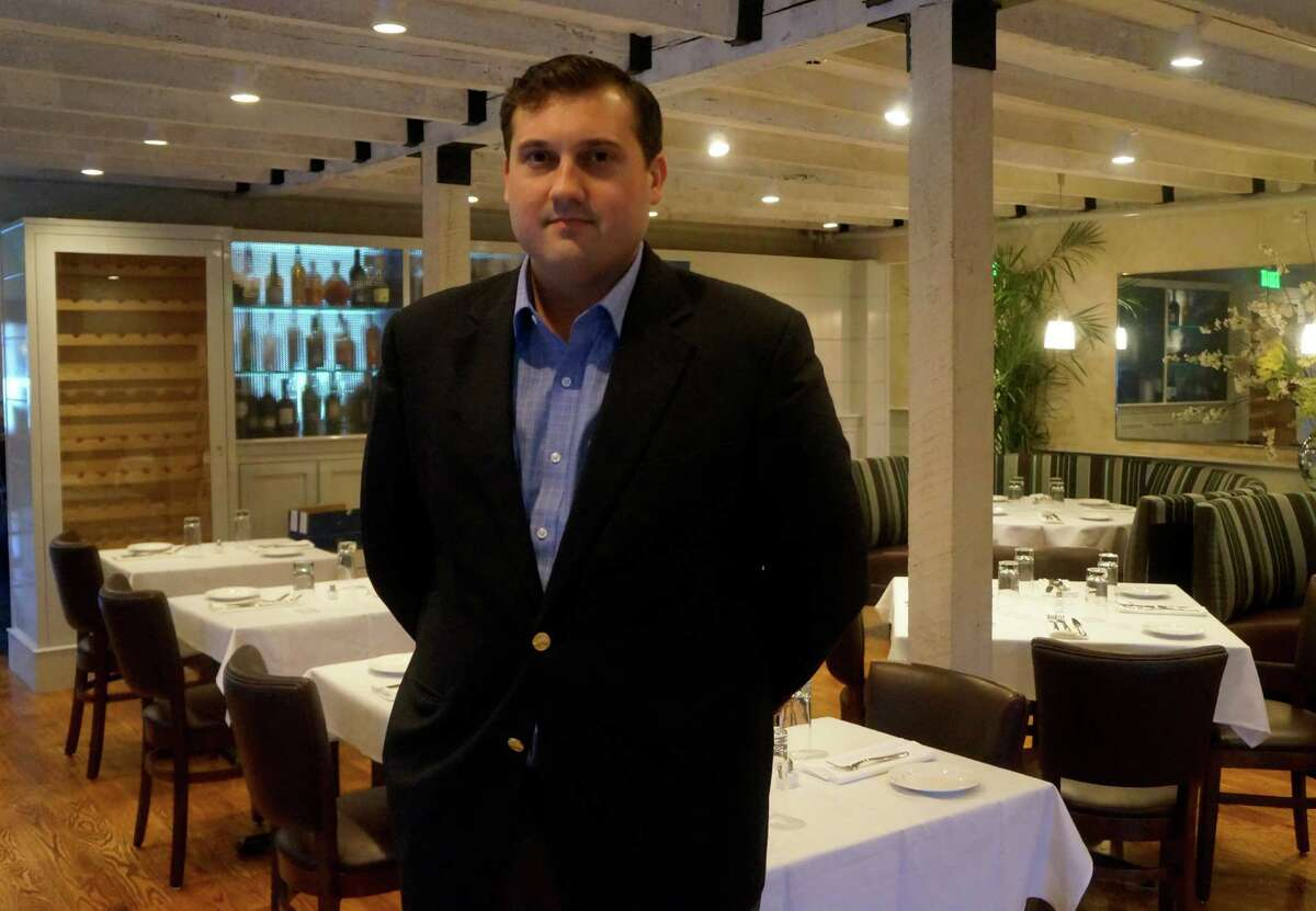 Jay Stasko,one of the owners of the owners of the new restaurant, 323 Main, in the renovated dining room before it opened for business Tuesday evening. WESTPORT NEWS, CT 3/12/13