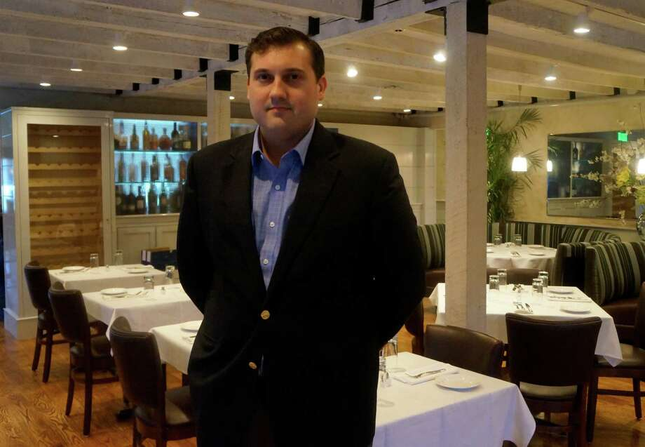 Jay Stasko,one of the owners of the owners of the new restaurant, 323 Main, in the renovated dining room before it opened for business Tuesday evening.  WESTPORT NEWS, CT 3/12/13 Photo: Paul Schott / Westport News