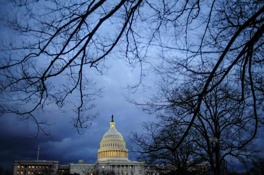 Dark clouds hang over the U.S. Capitol in Washington, D.C., U.S., on Thursday, Feb. 28, 2013. It's fiscal standoff time ... again. But on Wall Street, there is a sense of calm, with the Washington worriers playing the role of the boy who cried wolf. They'll work it out because they always work it out, goes this logic. Photographer: Pete Marovich/Bloomberg Photo: Pete Marovich, Bloomberg / © 2013 Bloomberg Finance LP
