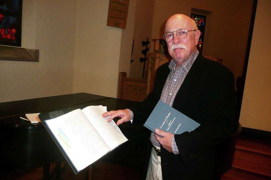 "Mickey Robinson is a retired retailer and Greenwich resident with a new avocation, genealogical research. Here, he stands next to a research book, ""Cavaliers and Pioneers: Abstracts of Virginia Land Patents and Grants,"" and holds another, ""The Ladner Odyssey,"" about his wife's Mississippi roots. Photo: Anne W. Semmes"