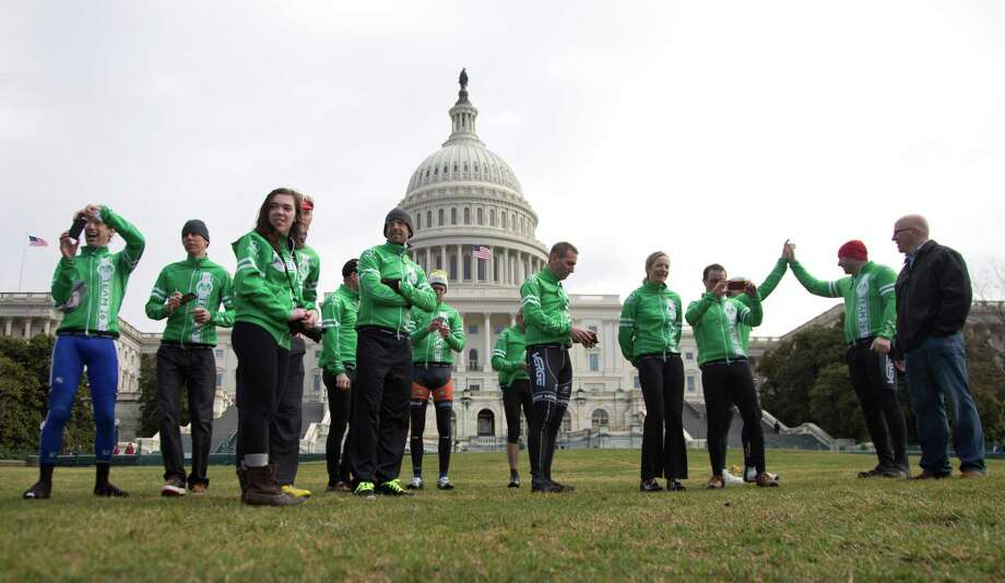 Members of the Sandy Hook Ride on Washington, a team of 26 cyclists who rode almost 400 miles from Newtown, Conn., to the Capitol in Washington in support of gun violence prevention gather for a news conference on Capitol Hill, Tuesday, March 12, 2013, in Washington. Photo: Carolyn Kaster, AP Photo/Carolyn Kaster / Associated Press