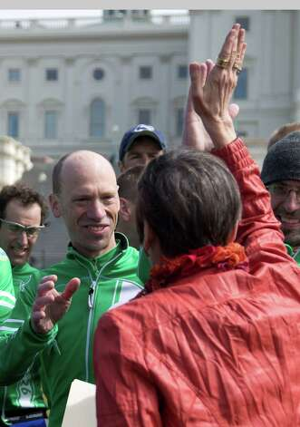 Rep. Rosa DeLauro, D-Conn., right, high-fives Monte Frank, organizer and member of the Sandy Hook Ride on Washington, during a news conference on Capitol Hill in Washington, Tuesday, March 12, 2013. The Sandy Hook Ride on Washington group, a team of 26 cyclists rode from from Newtown, Conn. to the Capitol to call for legislation to curb gun violence. Photo: Carolyn Kaster, AP Photo/Carolyn Kaster / Associated Press