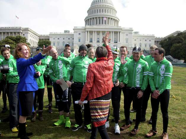 Rep. Rosa DeLauro, D-Conn., center, and Rep. Elizabeth Esty, D-Conn., left, greet members of the Sandy Hook Ride on Washington, including organizer Monte Frank, third from left, on Capitol Hill in Washington, Tuesday, March 12, 2013, as the team of 26 cyclists who rode from Newtown, Conn., to the Capitol to call for legislation to curb gun violence, gathered for a news conference. Photo: Carolyn Kaster, AP Photo/Carolyn Kaster / Associated Press