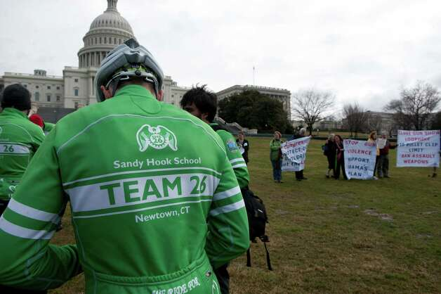 Riders talk with press before the start of the press conference on the West Front Lawn of the U.S. Capitol.  The Sandy Hook Ride on Washington was  a team of 26 cyclists riding almost 400 miles from Newtown, Connecticut to the Capitol in Washington, DC in support of commonsense solutions to prevent gun violence. Photo: Douglas Graham, Douglas Graham/Roll Call/Getty I / © 2012 CQ Roll Call Getty Images