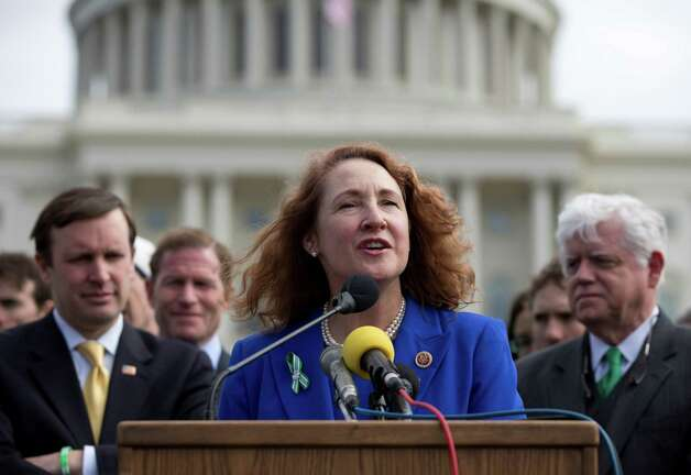 Rep. Elizabeth Esty, D-Conn., center, speaks during a news conference on Capitol Hill in Washington, Tuesday, March 12, 2013, to greet members of the Sandy Hook Ride on Washington, a team of 26 cyclists who rode from Newtown, Conn. to the Capitol to call for legislation to curb gun violence. From left are, Sen. Chris Murphy, D- Conn., Sen. Richard Blumenthal, D-Conn., Esty, Rep. John Larson, D-Conn. Photo: Carolyn Kaster, AP Photo/Carolyn Kaster / Associated Press
