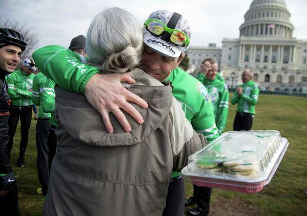 Suzie Gerakines, left, gives Matt Baldwin some cookies and a hug before news conference on Capitol Hill on Capitol Hill in Washington, Tuesday, March 12, 2013, for members of the Sandy Hook Ride on Washington, a team of 26 cyclists who rode from Newtown, Conn. to the Capitol to call for legislation to curb gun violence. Baldwin was one of the 26 cyclists. Photo: Carolyn Kaster, AP Photo/Carolyn Kaster / Associated Press