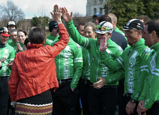 Rep. Rosa DeLauro, D-Conn., high fives the riders from Newtown at a press conference on the West Front Lawn of the U.S. Capitol. The cyclist of the Sandy Hook Ride on Washington, a team of 26 cyclists rode almost 400 miles from Newtown, Connecticut to the Capitol in Washington, DC in support of commonsense solutions to prevent gun violence. Photo: Douglas Graham, Douglas Graham/Roll Call/Getty I / © 2012 CQ Roll Call Getty Images
