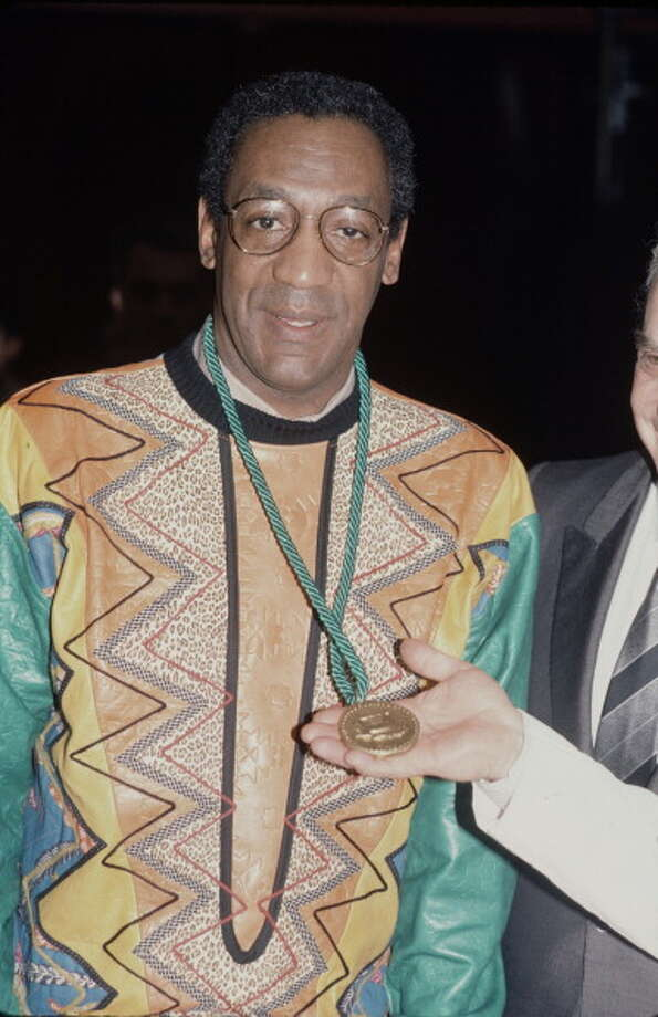 Two questions: Did Bill Cosby wear that sweater to an event in which he received a medal? Or did that medal come with the sweater? Photo: Time & Life Pictures, Time Life Pictures/Getty Images / Getty Images