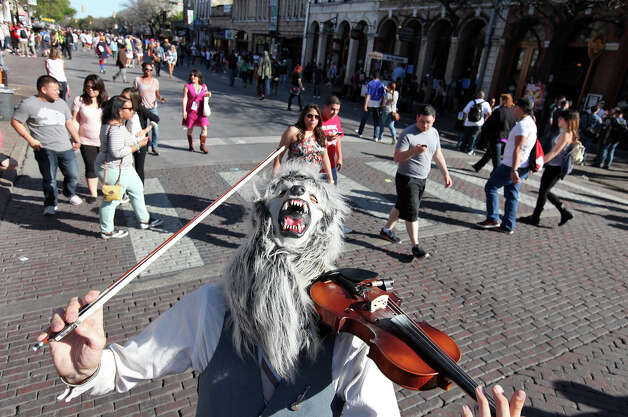 "The ""Violin Monster""performs on 6th Street during South by Southwest Tuesday March 12, 2013 in Austin, TX. Photo: Edward A. Ornelas, San Antonio Express-News / © 2013 San Antonio Express-News"