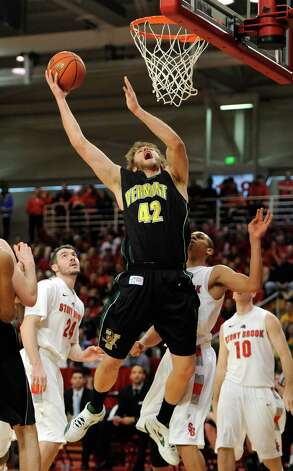 Vermont's Ben Crenca (42) shoots between Stony Brook's Tommy Brenton (24) and Al Rapier during the second half of the America East Conference tournament championship NCAA college basketball game on Saturday, March 10, 2012, in Stony Brook, NY. (AP Photo/Kathy Kmonicek) Photo: Kathy Kmonicek / FR170189 AP