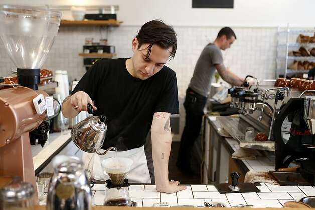 Paris Hynes makes a coffee drink at the Mill, which opened last month on Divisadero Street, two blocks north of Bi-Rite in the soon-to-be-named Divisadero commercial district. Photo: Beck Diefenbach, Special To The Chronicle