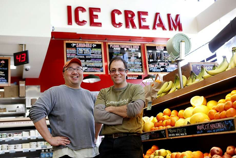 Bi-Rite Market co-owners Calvin Tsay (left) and Sam Mogannam celebrate their new Divisadero Street store, which opens Wednesday. Photo: Beck Diefenbach, Special To The Chronicle