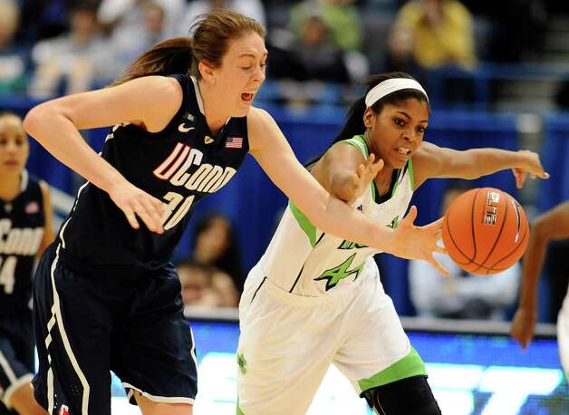 Connecticut's Breanna Stewart, left, steals the ball from Notre Dame's Ariel Braker, right, in the second half of an NCAA college basketball game in the final of the Big East Conference women's tournament in Hartford, Conn., Tuesday, March 12, 2013. (AP Photo/Jessica Hill) Photo: Jessica Hill, Associated Press / FR125654 AP