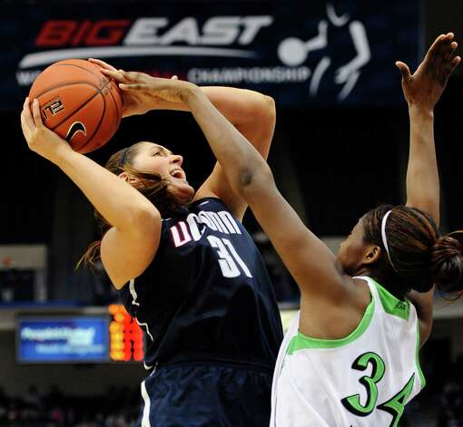 Connecticut's Stefanie Dolson drives to the basket while guarded by Notre Dame's Markisha Wright, right, in the second half of an NCAA college basketball game in the final of the Big East Conference women's tournament in Hartford, Conn., Tuesday, March 12, 2013. (AP Photo/Jessica Hill) Photo: Jessica Hill, Associated Press / FR125654 AP